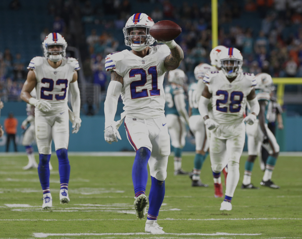 Bills safety Jordan Poyer celebrates after his interception with less than a minute remaining clinched Buffalo's 22-16 win Sunday against the Dolphins, sending the Bills to the playoffs.