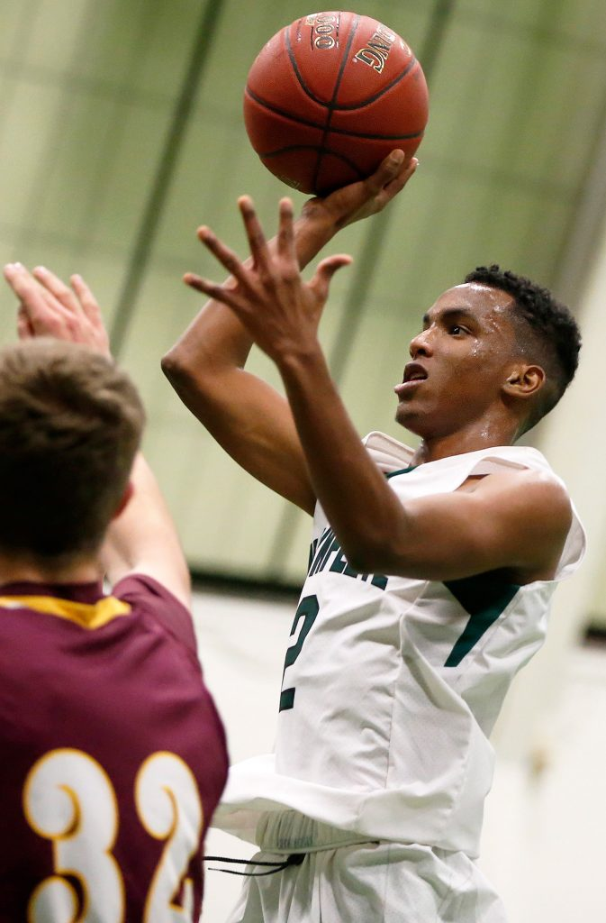 Waynflete's Askar Hussein takes a shot against Cape Elizabeth in Wednesday night's game in Portland. Hussein led the Flyers with 18 points.