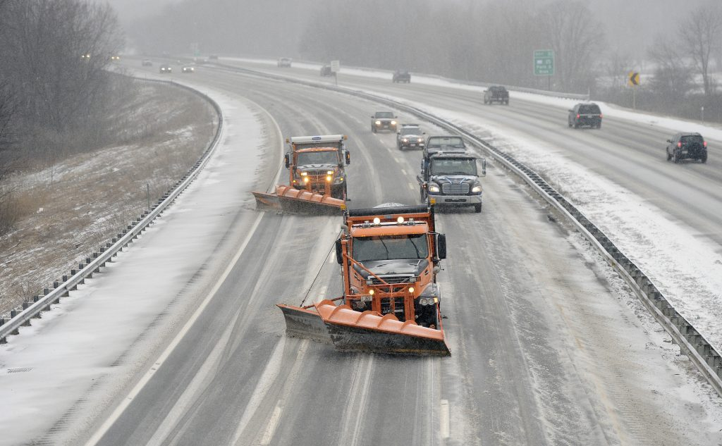 To combat a chronic shortage of full-time transportation workers in southern Maine, the state is paying private contractors to drive plow trucks and work on road crews. Roughly 24 contractors are expected to work for Maine Department of Transportation road crews in Freeport, Alfred and Yarmouth through October 2018. The department has had difficulty recruiting and keeping workers in York and Cumberland counties, where a strong economy is siphoning current and potential employees into better-paying municipal and private-sector jobs. The department has about 50 openings. First Vehicle Services, based in Cincinnati, was awarded a contract in September to provide 10 year-round hourly workers in both Freeport and Alfred, with a provision to expand to 40 more workers. The department has already asked for four more workers based in Yarmouth. Above, snowplows make their way up the Maine Turnpike in Saco at the start of a snowfall.