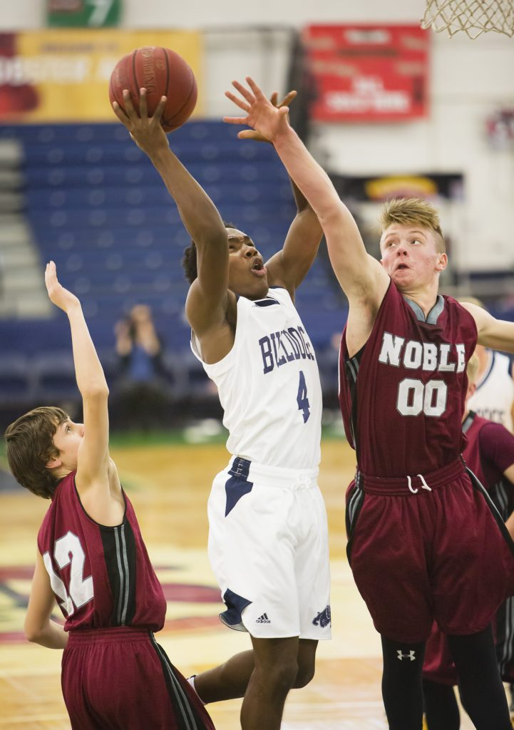 The official start to the high school basketball season is Friday night, but Portland and Noble got an early start on Thursday at the Portland Expo. The defending state champion Bulldogs had a scheduling conflict with the Maine Red Claws, so Portland played Thursday and guard Terion Moss started strong, driving to the hoop against Noble's Garrett Brown. Moss scored 40 points and Portland won th
