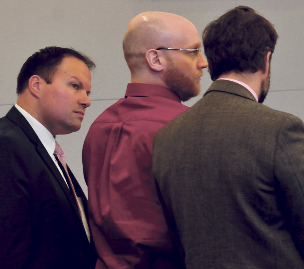 Robert Burton, center, with his attorneys, Zachary Brandmeir, left, and Hunter Tzovarras, at Penobscot Judicial Center in Bangor, listens to his guilty verdicts being read.