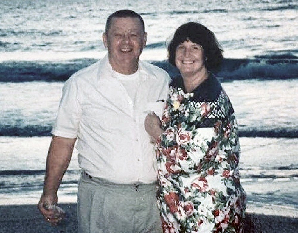 Clyde and Kim Shue are seen in an undated family photo. Police say that the married couple died in an apparent murder-suicide in their Manchester home on Saturday, with Clyde apparently shooting his wife and then himself.