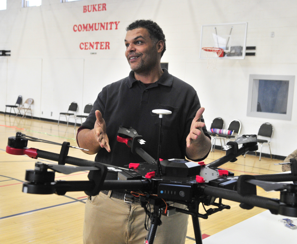 Kristopher Kleva talks about a large industrial drone during a demonstration for Augusta Boys and Girls Club on Friday at The Buker Center in Augusta.