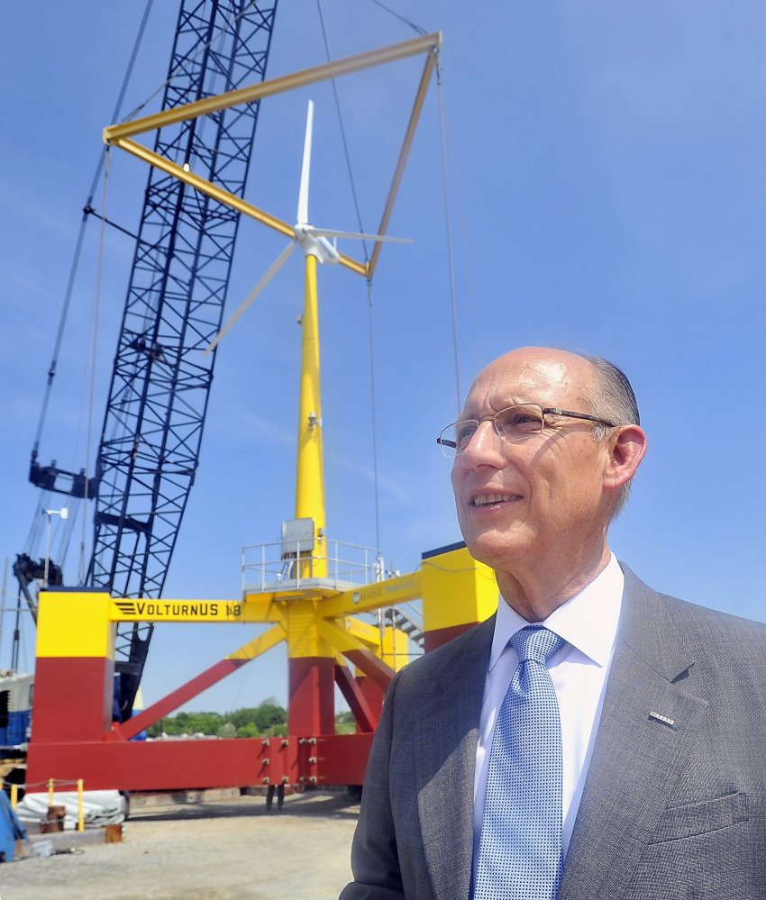 Peter Vigue, CEO of Cianbro, watches construction of a wind turbine in May 2013 at Cianbro's Eastern Manufacturing Facility in Brewer.