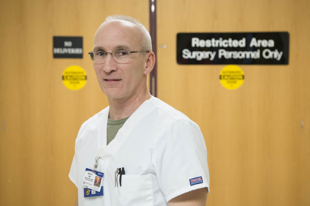 Eric Hewett, a surgery nurse at Inland Hospital, poses for a portrait at Inland Hospital on Dec. 22. Hewett was hit multiple times in the head while apprehending a man who broke in to his mother's home in Sidney in March.