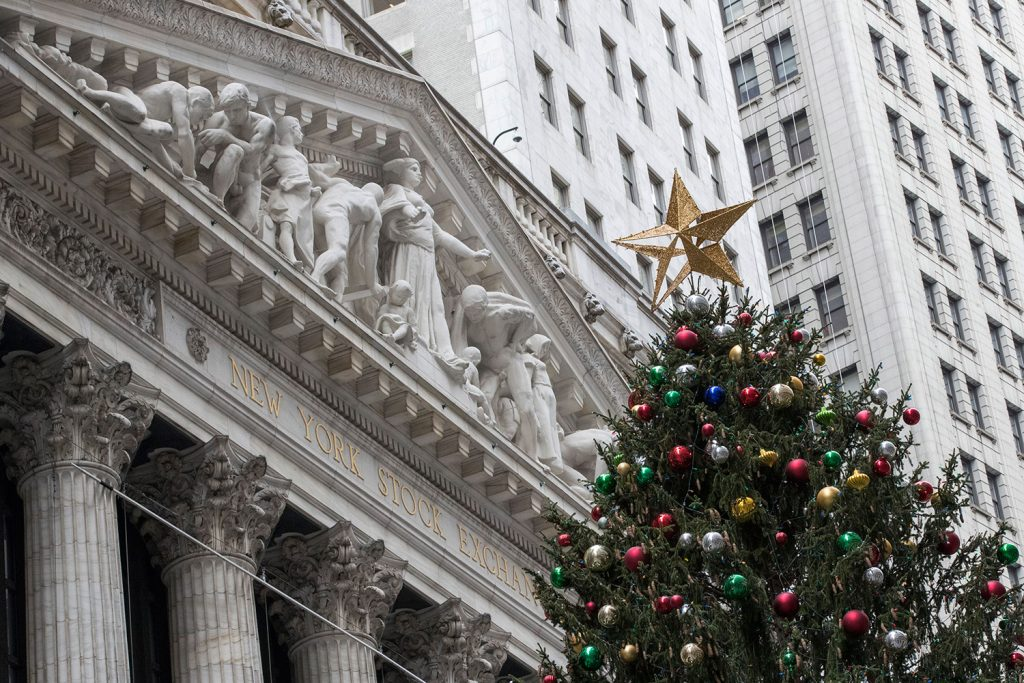 A golden star tops the Christmas tree outside the New York Stock Exchange on Thursday, when stocks powered to new highs. On Friday, however, stocks veered sharply lower on the news that former national security adviser Michael Flynn would plead guilty to lying to the FBI.