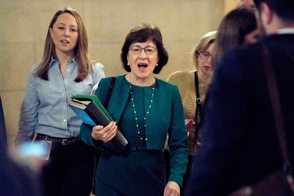 Sen. Susan Collins, R-Maine, center, arrives as Republican senators gather to meet with Senate Majority Leader Mitch McConnell, R-Ky., on the Republican effort to overhaul the tax code on Friday. Collins tweeted that she was gratified that senators agreed to incorporate her amendments into the bill.