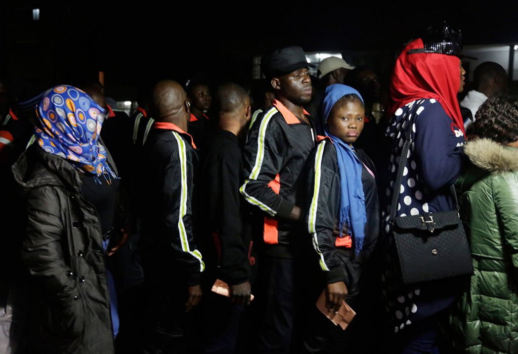 Nigerian returnees from Libya wait to be registered by officials upon arrival at Murtala Muhammed International Airport in Lagos, Nigeria, on Tuesday. Hundreds of Nigerians arrived in Lagos on Tuesday, having been repatriated from Libya by the African Union amid outrage over recent footage that showed migrants being auctioned off as slaves.