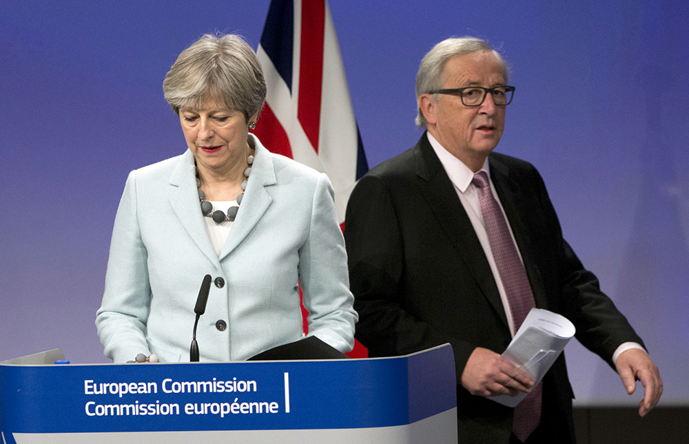 British Prime Minister Theresa May and European Commission President Jean-Claude Juncker prepare to address news media at EU headquarters in Brussels on Friday.