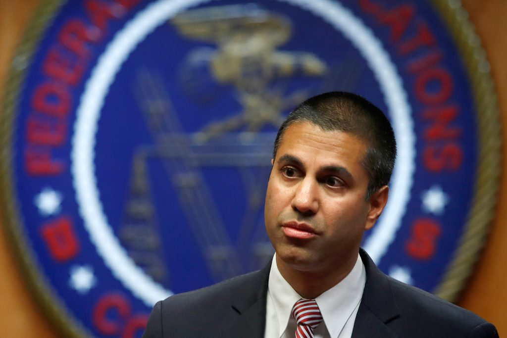 "Federal Communications Commission Chairman Ajit Pai arrives for Thursday's meeting on net neutrality. He said, ""Quite simply, we are restoring the light-touch framework that has governed the internet for most of its existence."""