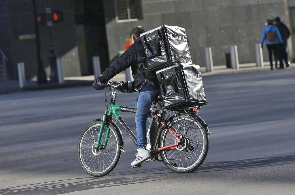 A man makes deliveries on an electric bike in New York last week.