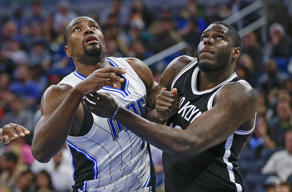 Then-Brooklyn Nets forward Anthony Bennett, right, battles Orlando Magic forward Serge Ibaka for a rebound during a game in Orlando on Dec. 16, 2016.