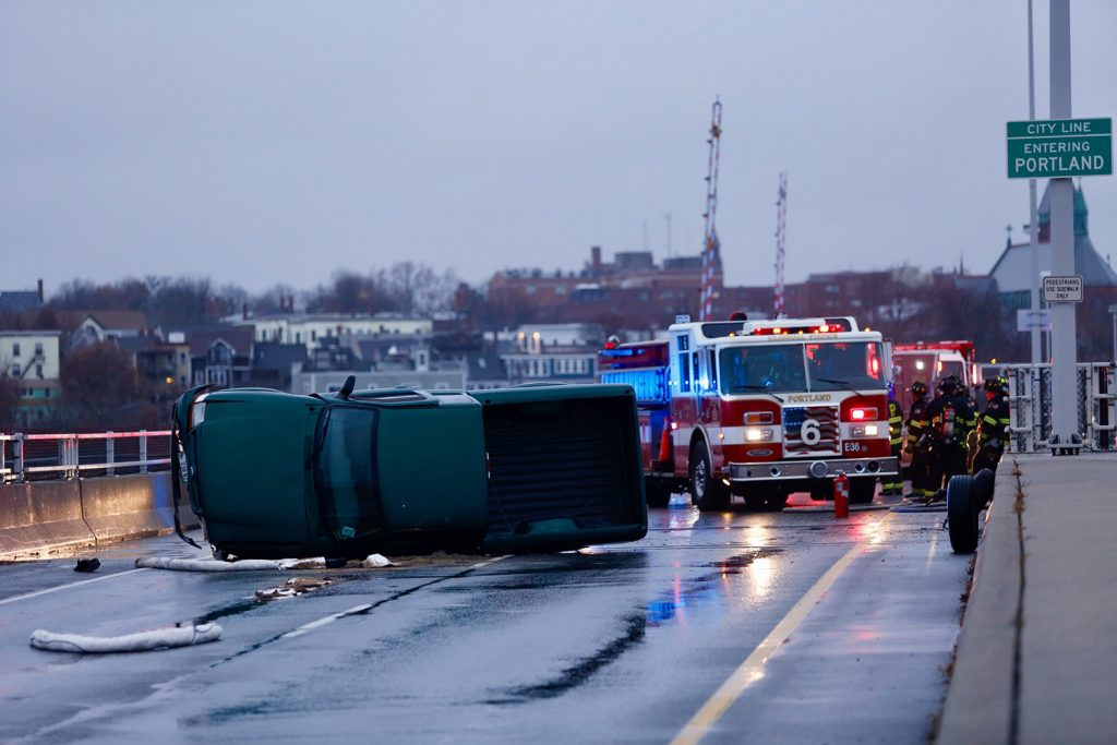 A truck overturned on the Casco Bay Bridge between Portland and South Portland on Tuesday afternoon, blocking both lanes of traffic headed into South Portland.