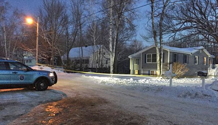 Police on the scene Dec. 20, 2017, on Massachusetts Avenue in Millinocket, where a home invasion occurred a day earlier. A man has pleaded guilty in the fatal shooting.