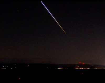 A meteor streaks across the sky Tuesday, as seen from the Mount Agamenticus webcam in York County.