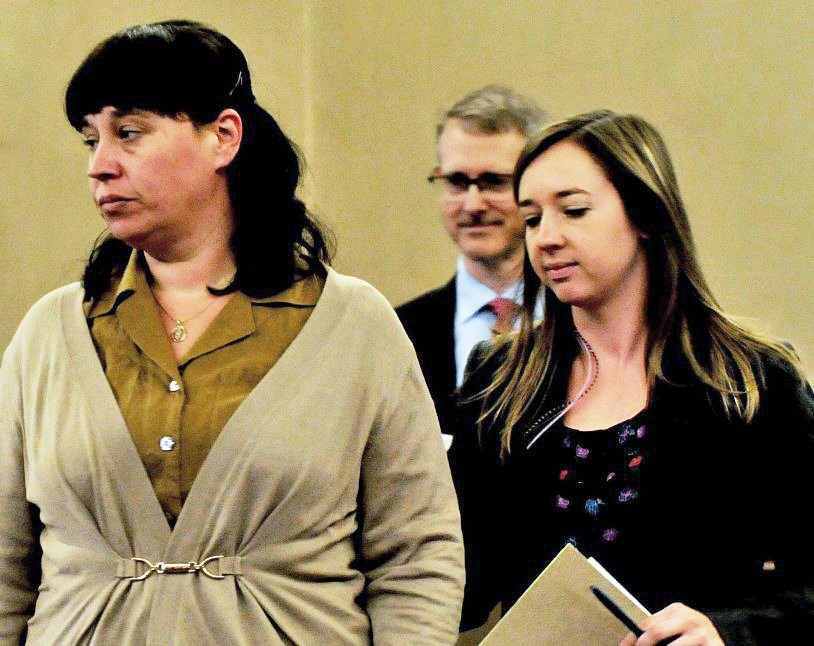 Miranda Hopkins, left, and her attorneys, Laura Shaw and Christopher MacLean appear in Waldo County Superior Court in Belfast for the start of her manslaughter trial on Oct 31.