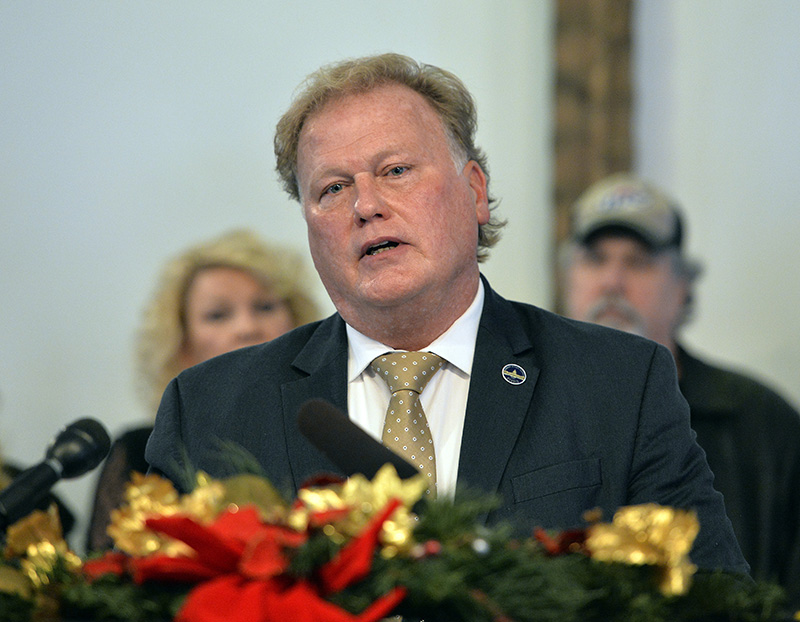 With friends and family standing behind him, Kentucky State Rep., Republican Dan Johnson addressed the public from his church on Dec. 12, 2017.