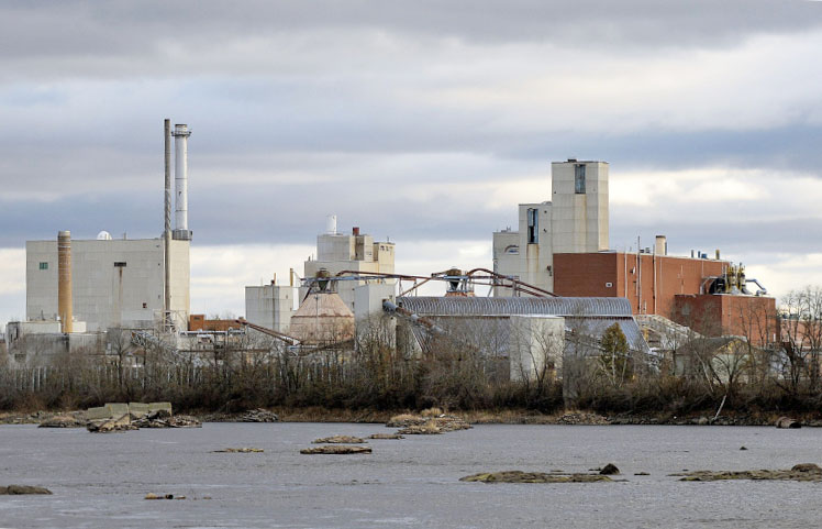 "Of 16 companies applying to help the University of Maine use the former Old Town paper mill site, above, for generating wood-fired steam and electricity, New York-based ConEdison Solutions won an ""award to negotiate."" It was chosen partly because it would use the mill's biomass boiler."