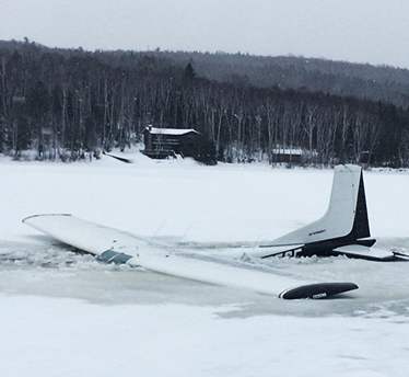 Warden Pilot Jeff Spencer's plane after it hit thin ice while landing on Eagle Lake.