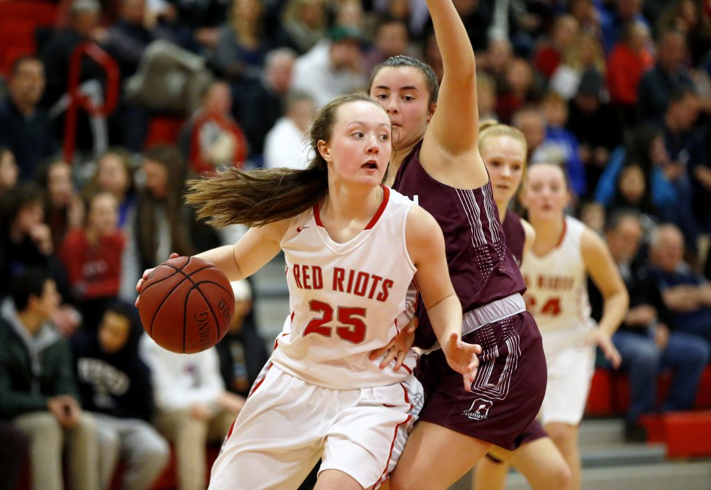 South Portland's Maggie Whitmore looks to pass while Greely's Emma Spoerri defends. Whitmore was the leading scorer for South Portland with 22 points, 19 in the second half.  The Red Riots won 63-53.