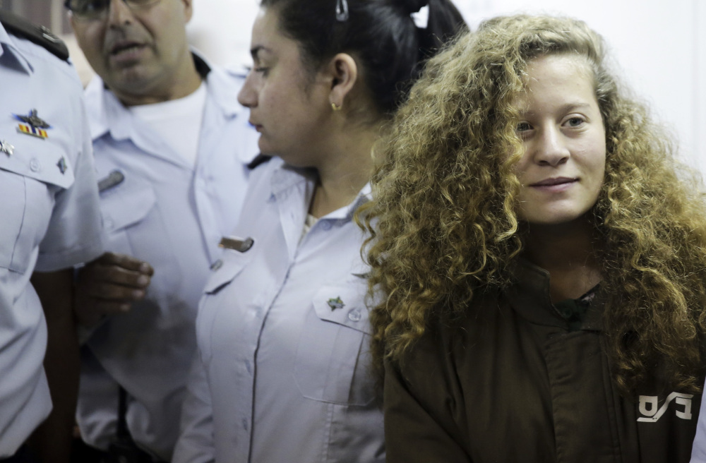 Ahed Tamimi is brought to a courtroom inside Ofer military prison near Jerusalem on Thursday. A military court indicted Tamimi, 16, on Monday for attacking Israeli soldiers as well as for previous altercations.