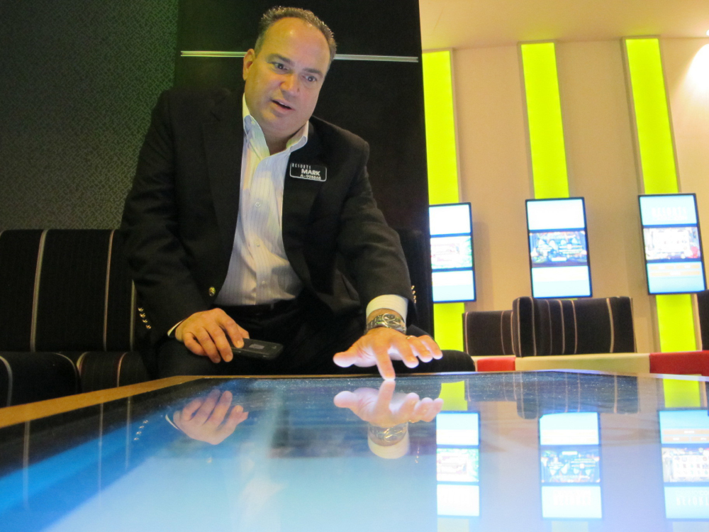 Mark Giannantonio, president of Resorts Casino Hotel in Atlantic City, N.J., demonstrates a tabletop internet gambling console at his casino. Resorts was the first U.S. casino to open outside Nevada.