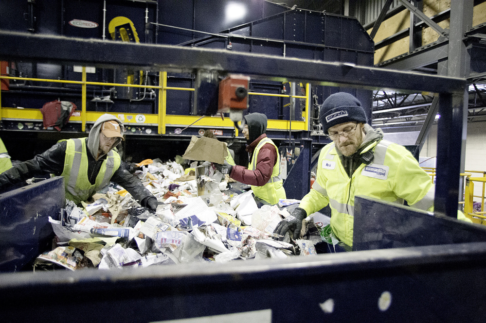 Employees sort recycled waste from area communities at the Casella Pine Tree Waste facility in Lewiston.