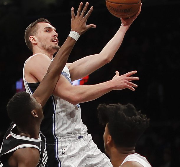 Orlando guard Mario Hezonja takes a shot while being guarded by Brooklyn's Caris LeVert during the Nets' 98-95 victory in New York.