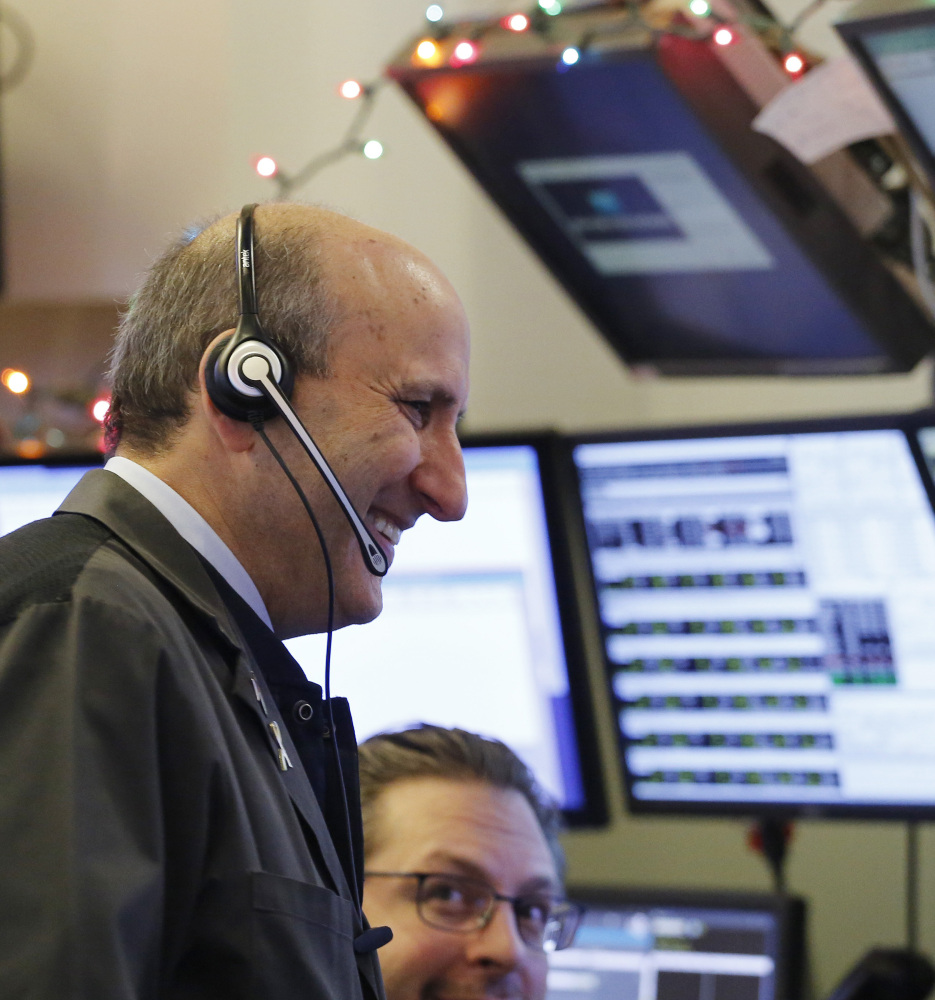 Traders work the stock exchange floor Tuesday as the Nasdaq had its best opening day since 2013.