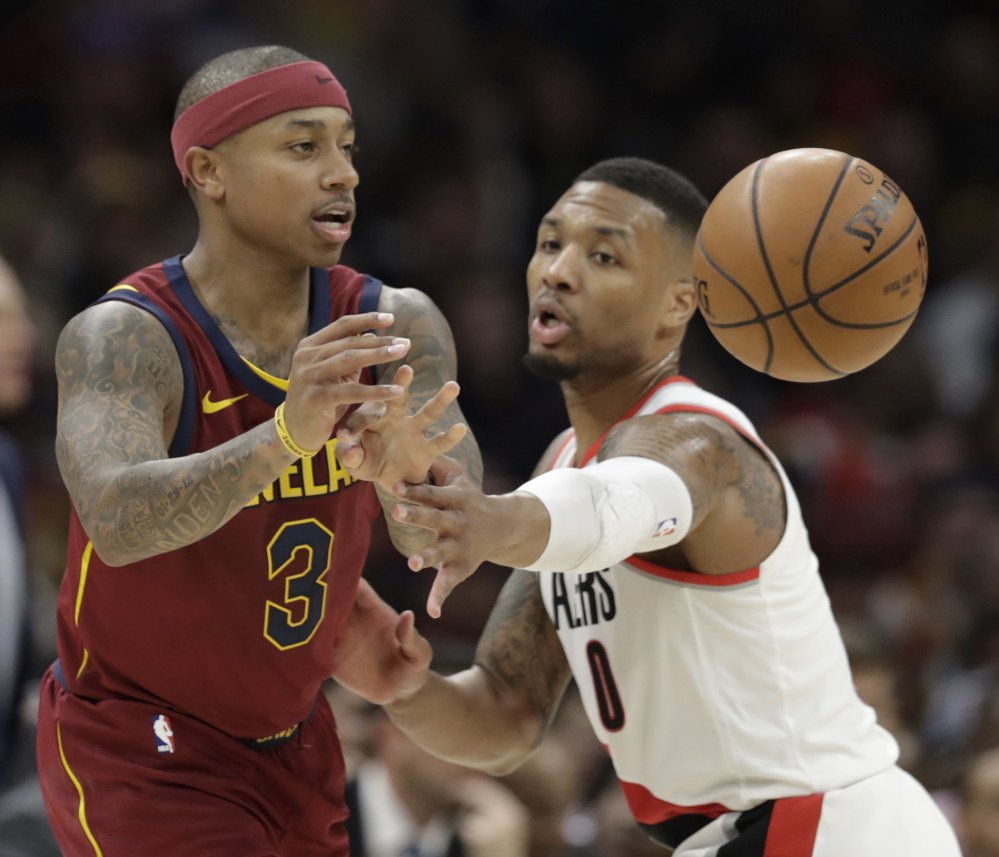 Isaiah Thomas, passing against Damian Lillard of Portland, scored 17 points in 19 minutes Tuesday night for Cleveland in his return.