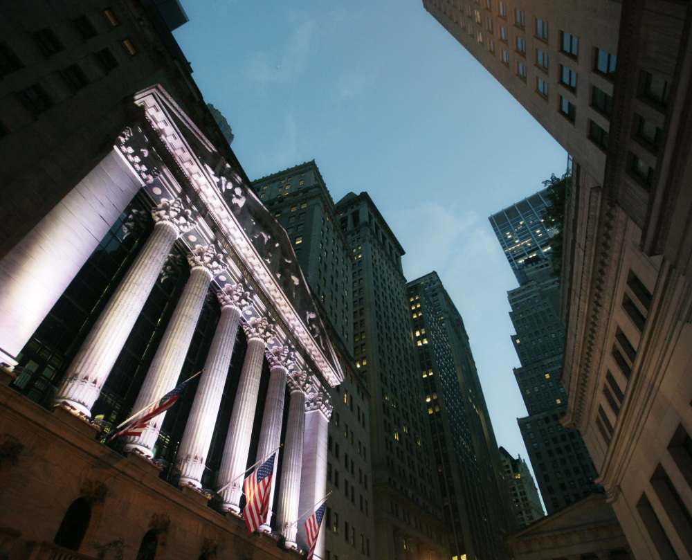 The New York Stock Exchange in 2014. The Standard & Poor's 500 index, the Dow Jones industrial average and the Nasdaq composite reached new heights Wednesday.