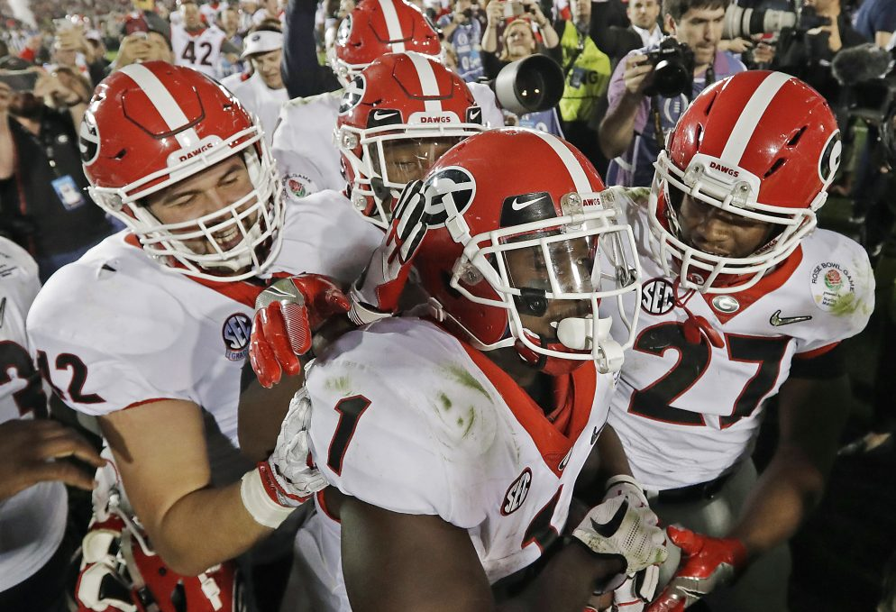 The Bulldogs were celebrating Monday night after Sony Michel, 1, scored the winning touchdown in the second overtime to give Georgia a 54-48 win over Oklahoma in the Rose Bowl. The Bulldogs must regroup and focus quickly because they are playing Alabama for the national title Monday night.