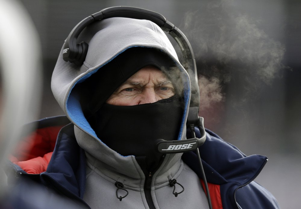 New England Patriots Coach Bill Belichick bundled against the cold weather last Sunday against the Jets at Foxborough, Mass. He left no room for error for his players getting to practice in spite of the storm that blanketed New England.