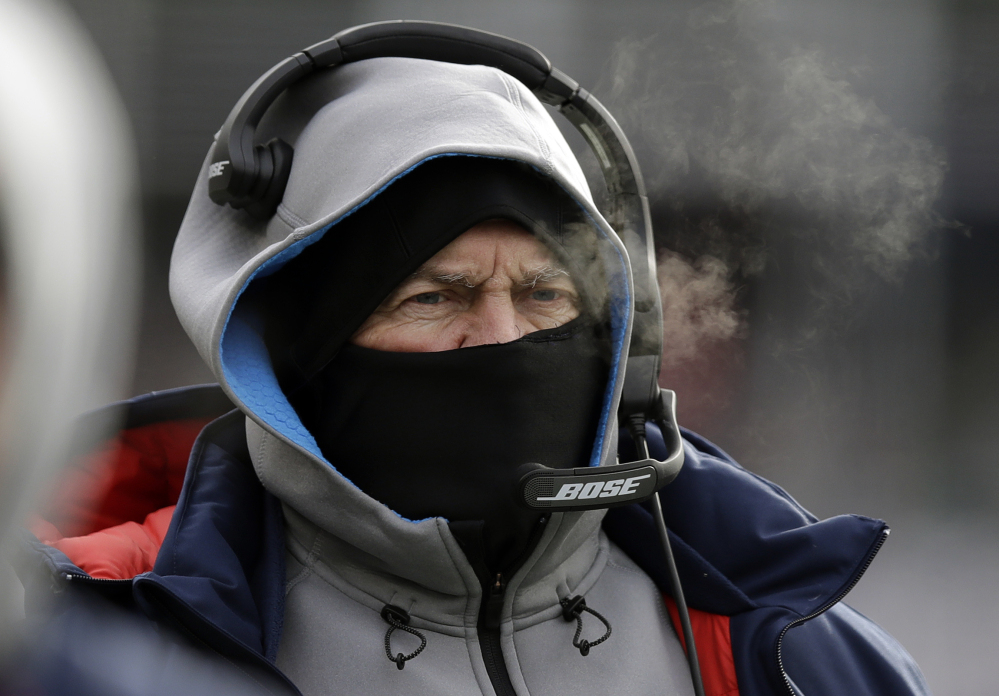 """New England Patriots Coach Bill Belichick bundled against the cold weather last Sunday against the Jets at Foxborough, Mass. He left no room for error for his players getting to practice in spite of the storm that blanketed New England. """"Every day's a work day,"""" Belichick said."""