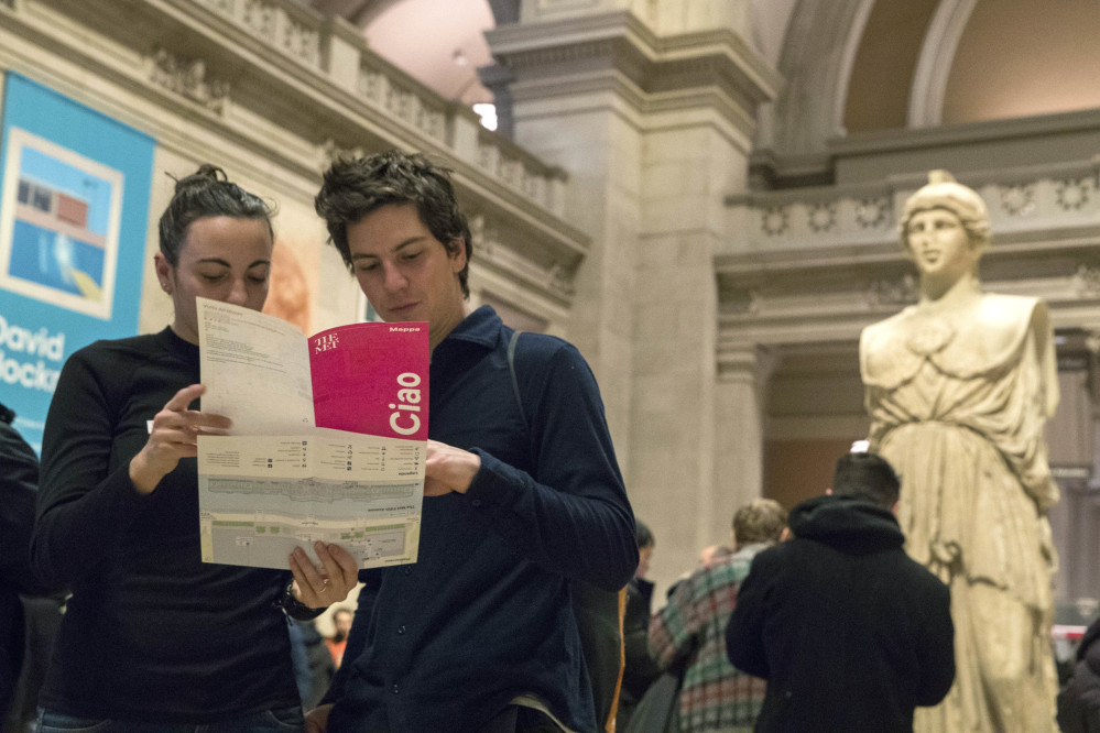 Visitors to the Metropolitan Museum of Art plan their route Thursday. Starting March 1, the museum will charge a mandatory $25 entrance fee to most adult visitors.