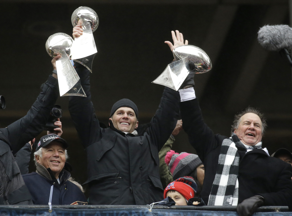 Patriots owner Robert Kraft, left, quarterback Tom Brady and Coach Bill Belichick have been together for five Super Bowl championships and are in contention for another title.