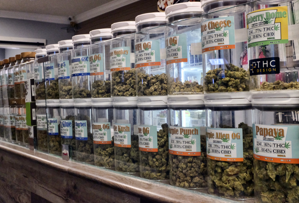 Jars of medical marijuana are on display on the counter of a marijuana dispensary in Los Angeles. All but four states allow some form of medical marijuana.