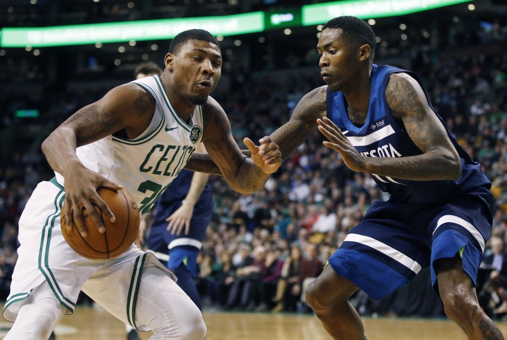 Minnesota's Jamal Crawford guards Boston's Marcus Smart in the second quarter of Friday night's game in Boston.