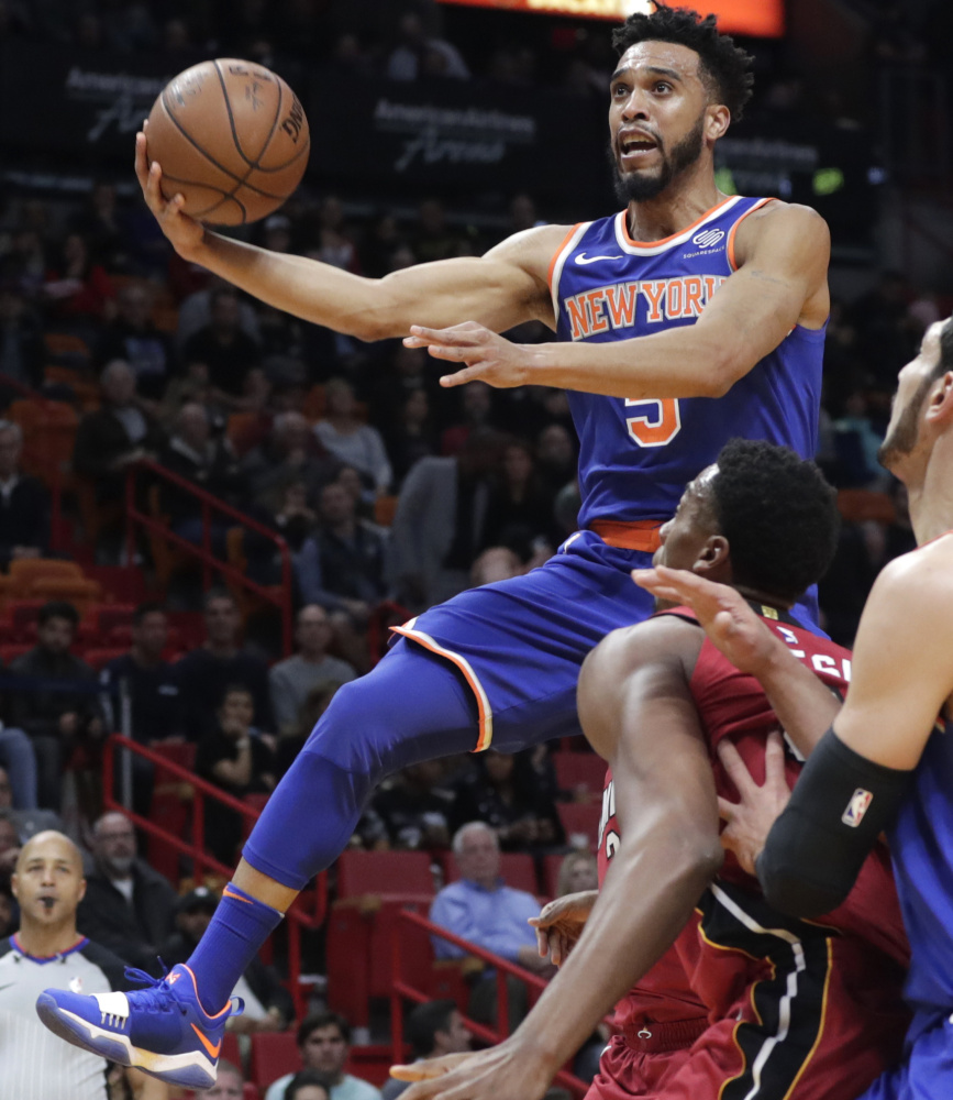 Courtney Lee of the New York Knicks drives past Hassan Whiteside of the Miami Heat during the first half of Miami's 107-103 overtime victory.