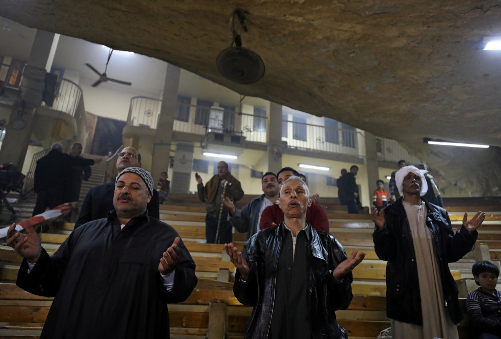 Coptic Orthodox Christians attend Christmas Eve Mass at a church in Saint Samaan the Tanner Monastery in Cairo, Egypt, on Saturday.