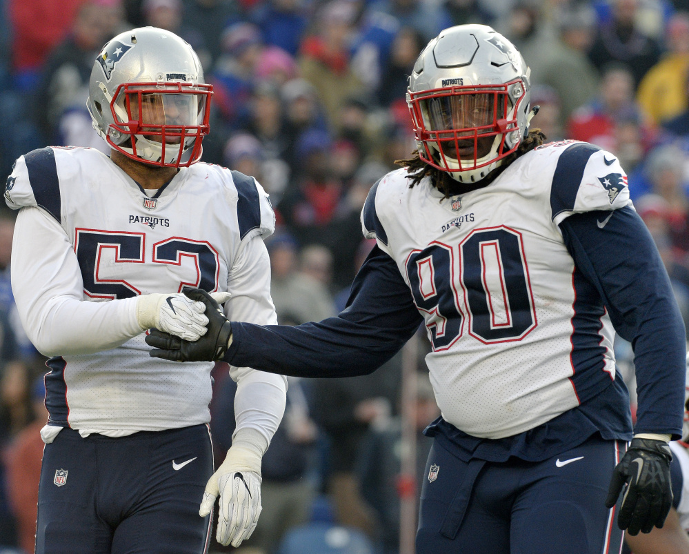 Linebacker Kyle Van Noy, left, and lineman Malcom Brown are among the defenders who will be counted on as the New England Patriots begin their playoff push to the Super Bowl.