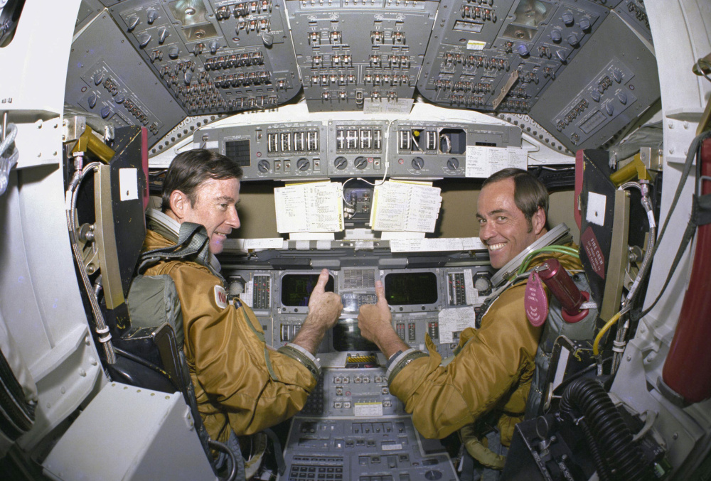 Space shuttle mission commander John Young and pilot Robert Crippen train for a mission in 1980.