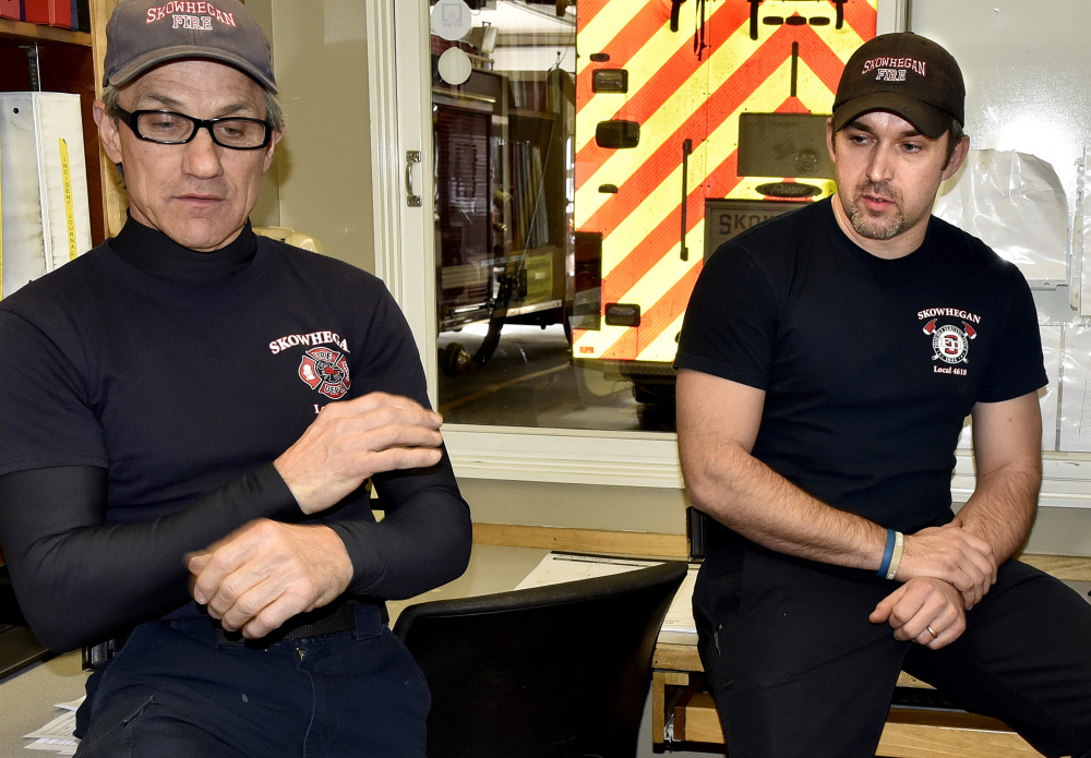 Skowhegan Fire Capt. Rick Caldwell, left, and firefighter Daryl Wyman talk Sunday about discovering the body of William Lashon in his mobile home.