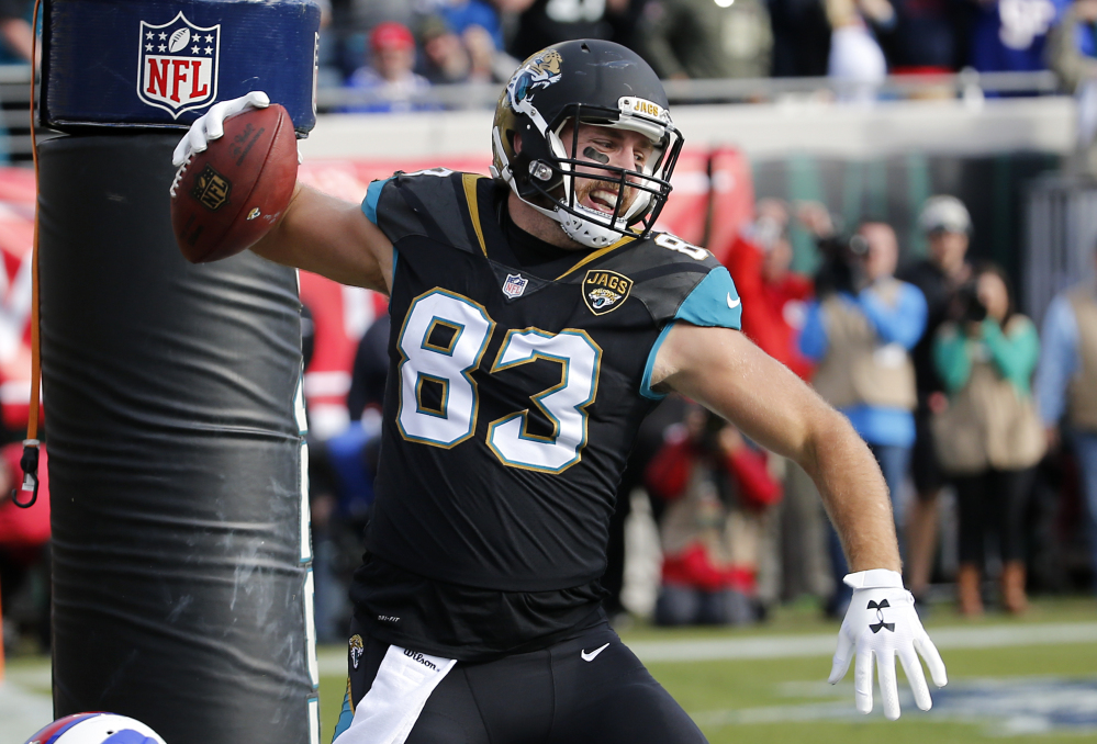 Jaguars tight end Ben Koyack spikes the ball after scoring a touchdown on a 1-yard pass in the third quarter of Jacksonsville's 10-3 win over Buffalo on Sunday in the AFC wild card game in Jacksonville, Florida.