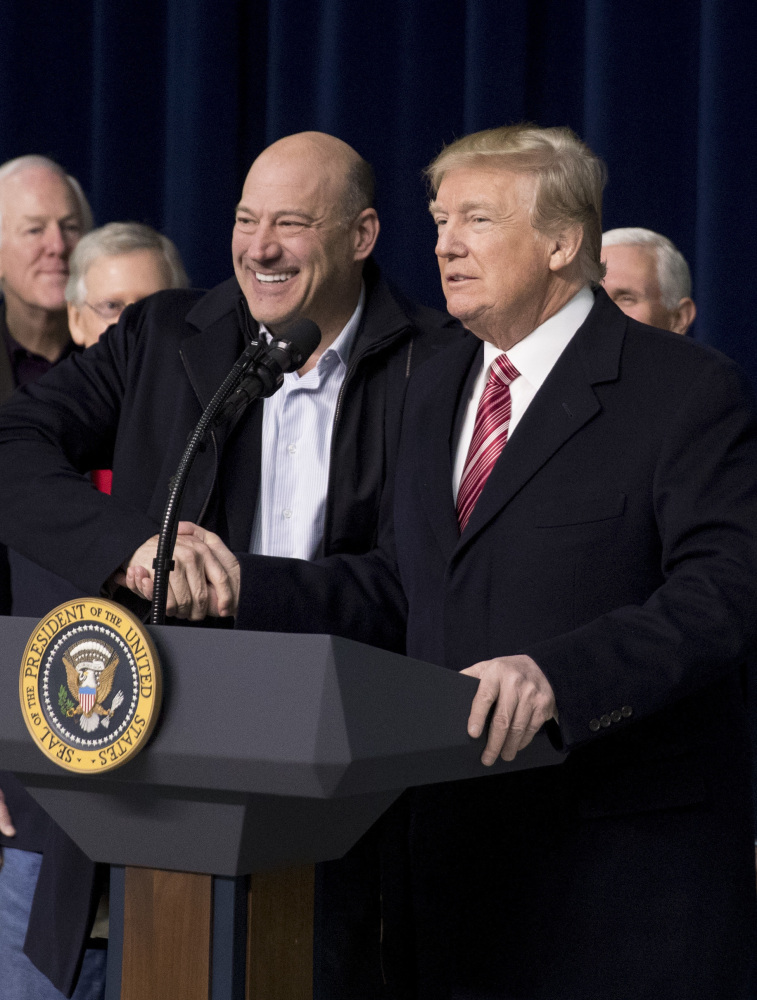 National Economic Council chairman Gary Cohn, left, shakes hands with President Trump, who asked Cohn to come to the podium after being asked a question by a member of the media about their relationship following the Congressional Republican Leadership Retreat at Camp David, Md., on Saturday.