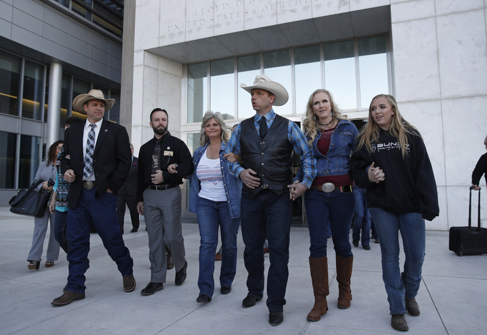 From left, Ammon Bundy, Ryan Payne, Jeanette Finicum, widow of Robert