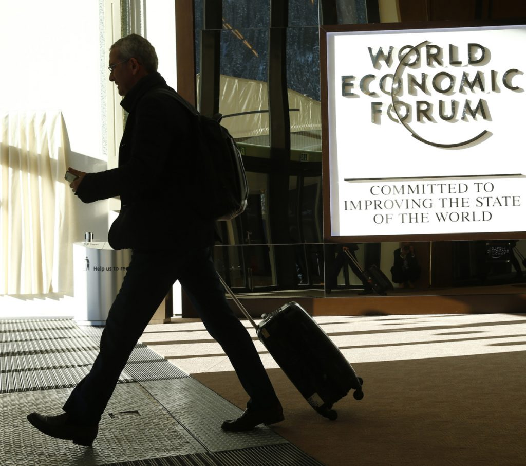 An attendee leaves the Congress Hall during the World Economic Forum in Davos, Switzerland, last year. Trump will be the first sitting U.S. president to attend the meeting since Bill Clinton.
