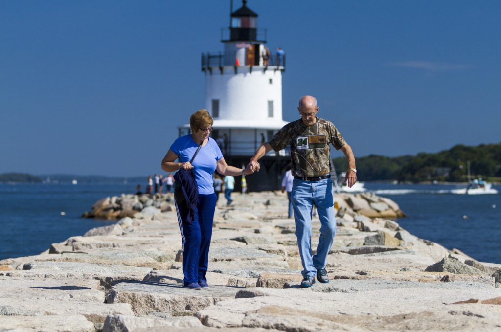 Visitors like Marie and Douglas Pyle of Lewisville, Texas, seen in South Portland during Open Lighthouse Day in 2015, bring $6 billion a year to Maine. Tourism and lobstering, a $1.7 billion-a-year industry, have an economic impact far greater than the fossil fuel industry ever could here.