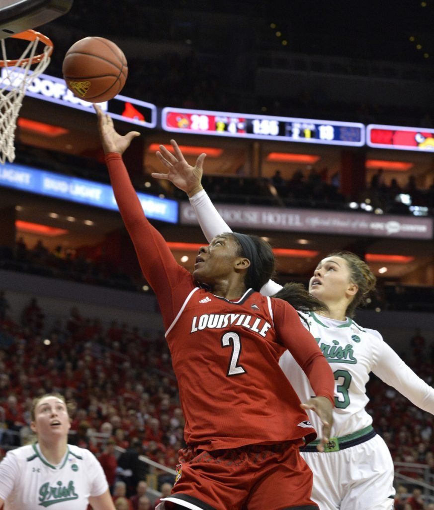 Louisville's Myisha Hines-Allen goes for a layup past Notre Dame's Kathryn Westbeld in the first half Thursday night in Louisville, Ky. Louisville crushed Notre Dame, 100-67.