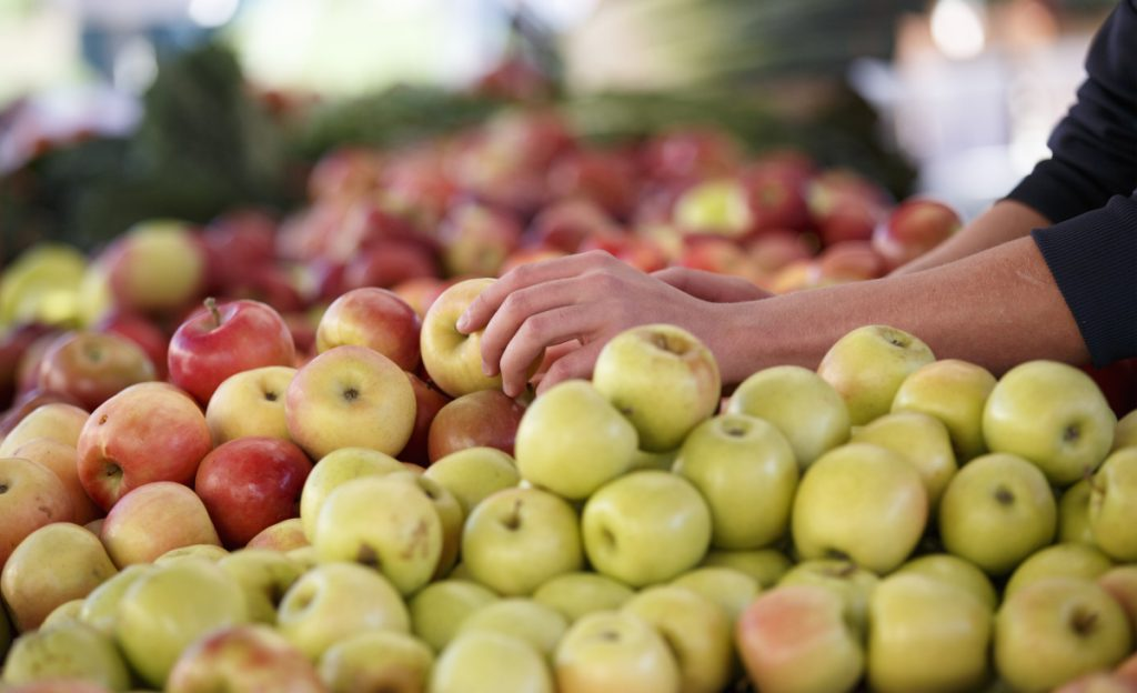 Apples are shown at a farmers market. A pesticide used on citrus fruits and other crops would be restricted under an EPA proposal.